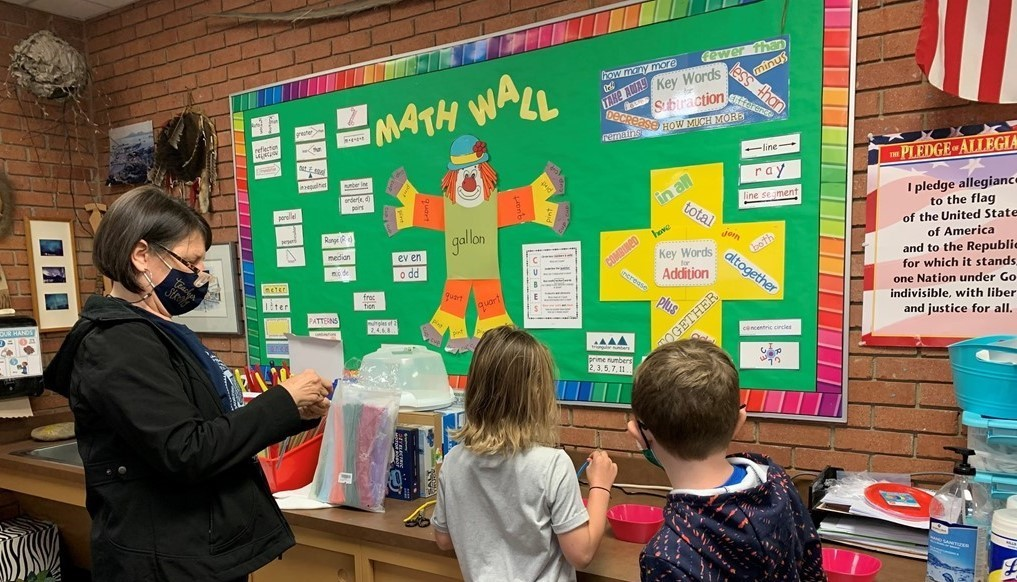 2nd Grade Checking Out the Math Wall