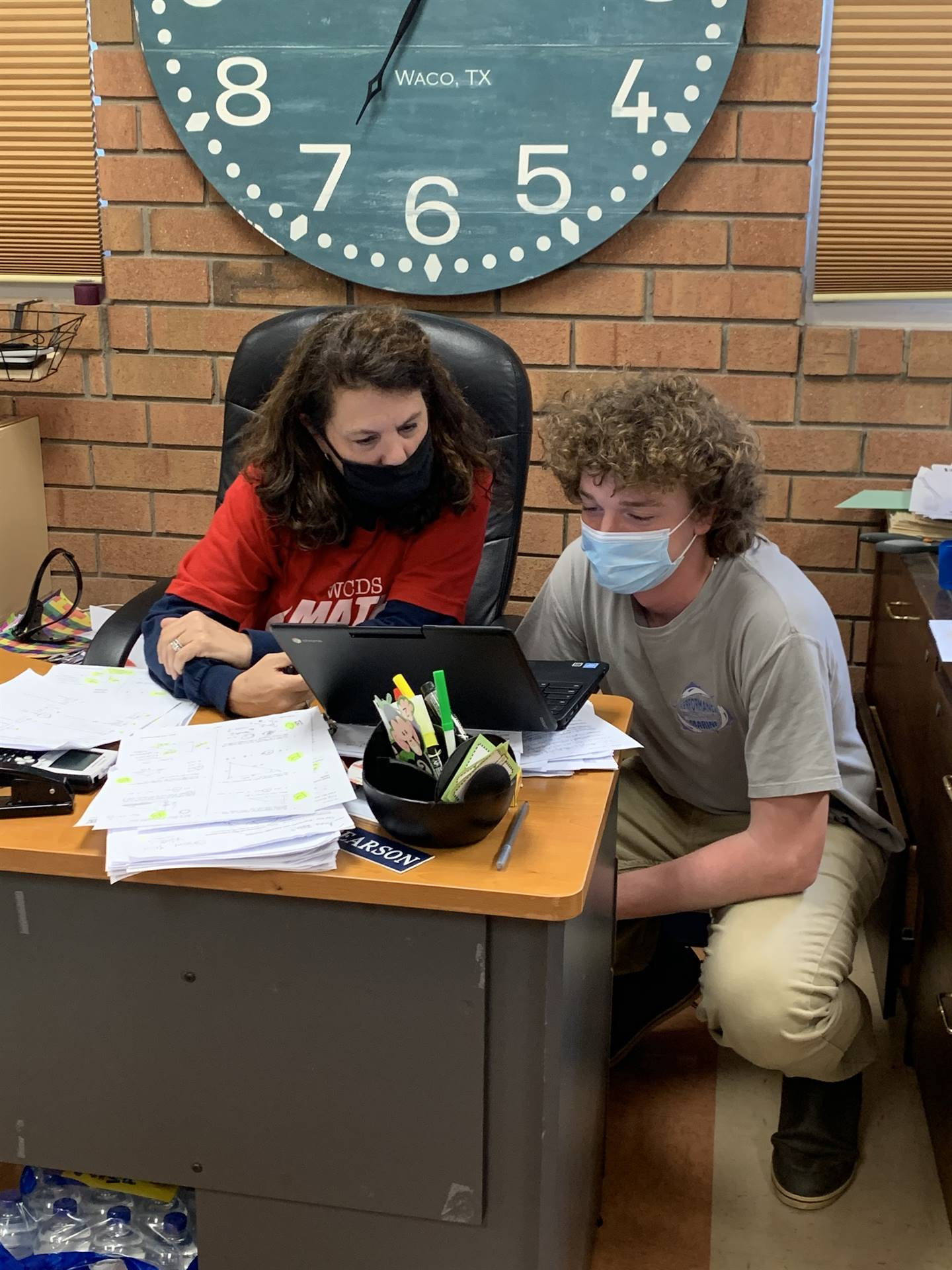 Middle School Student working with teacher