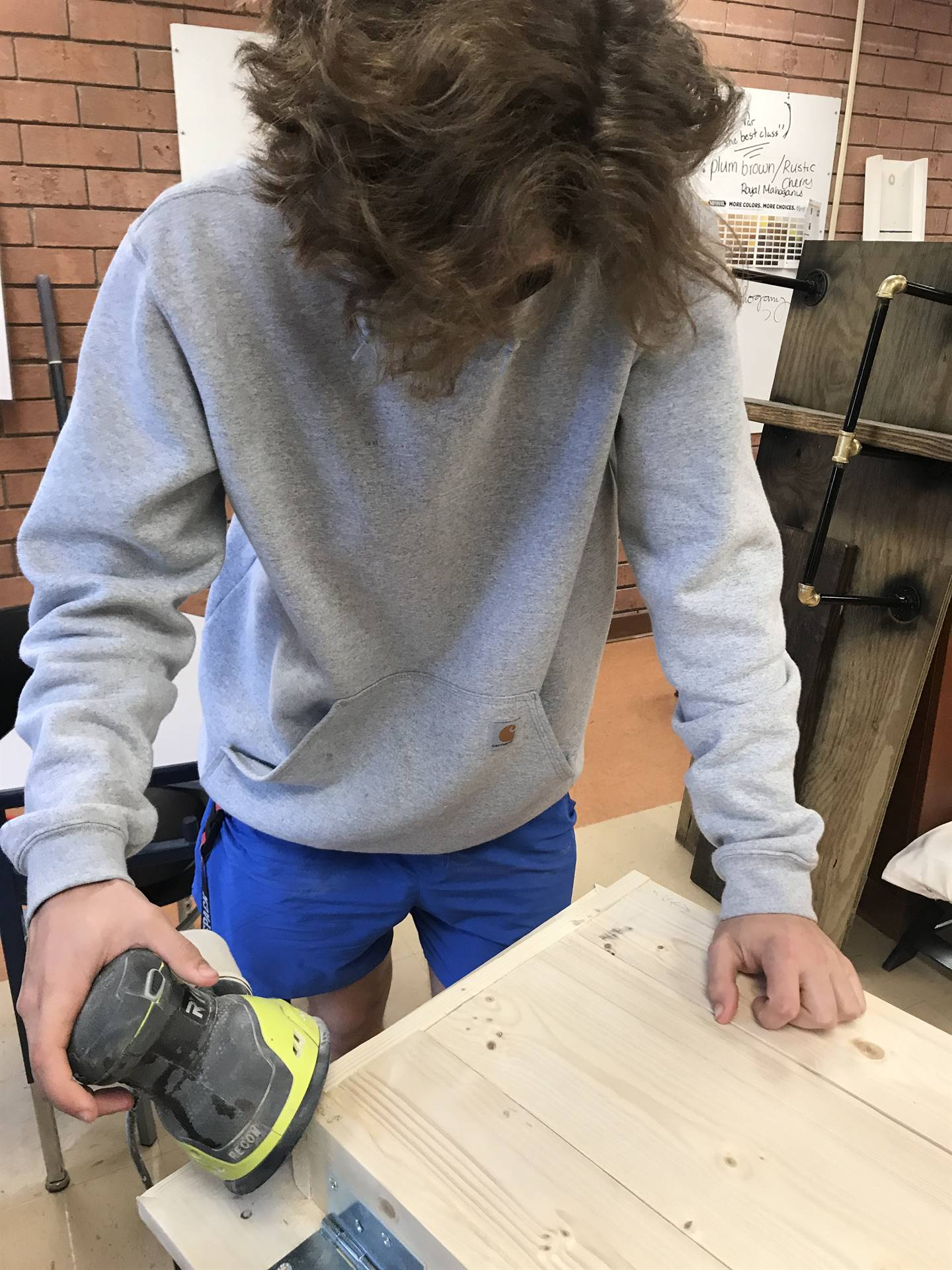 student sanding woodworking project
