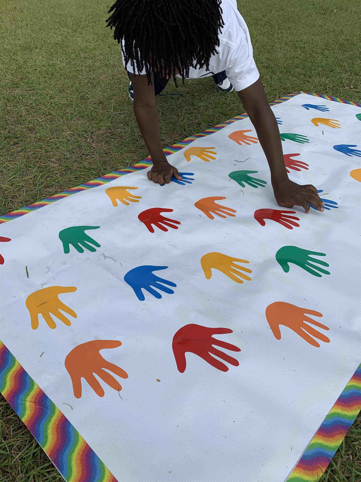 Student playing twister