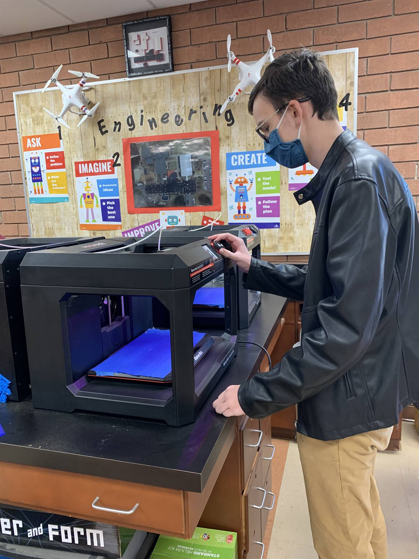 student working on 3D printer