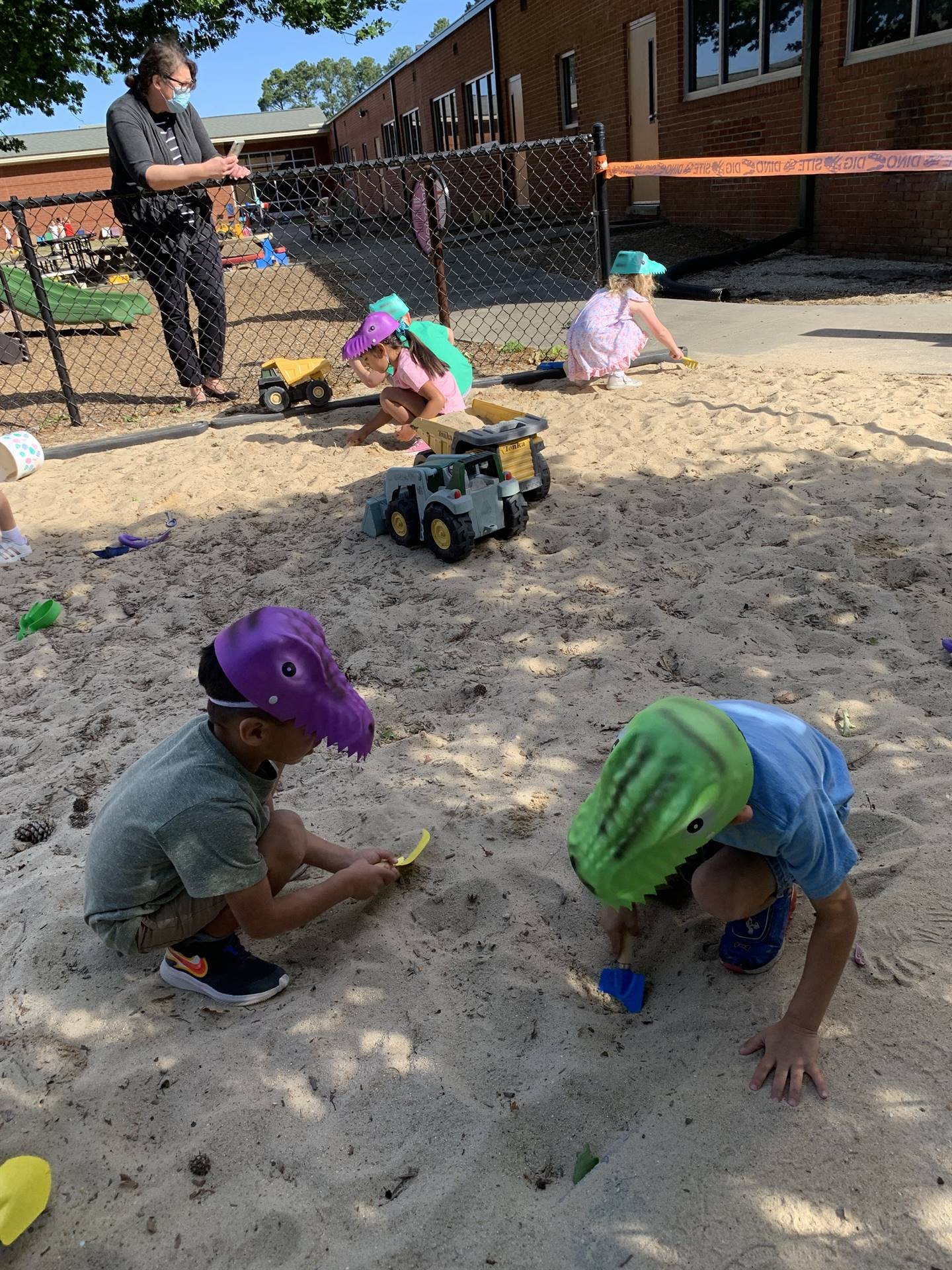 4K digging for dinosaur fossils on the playground