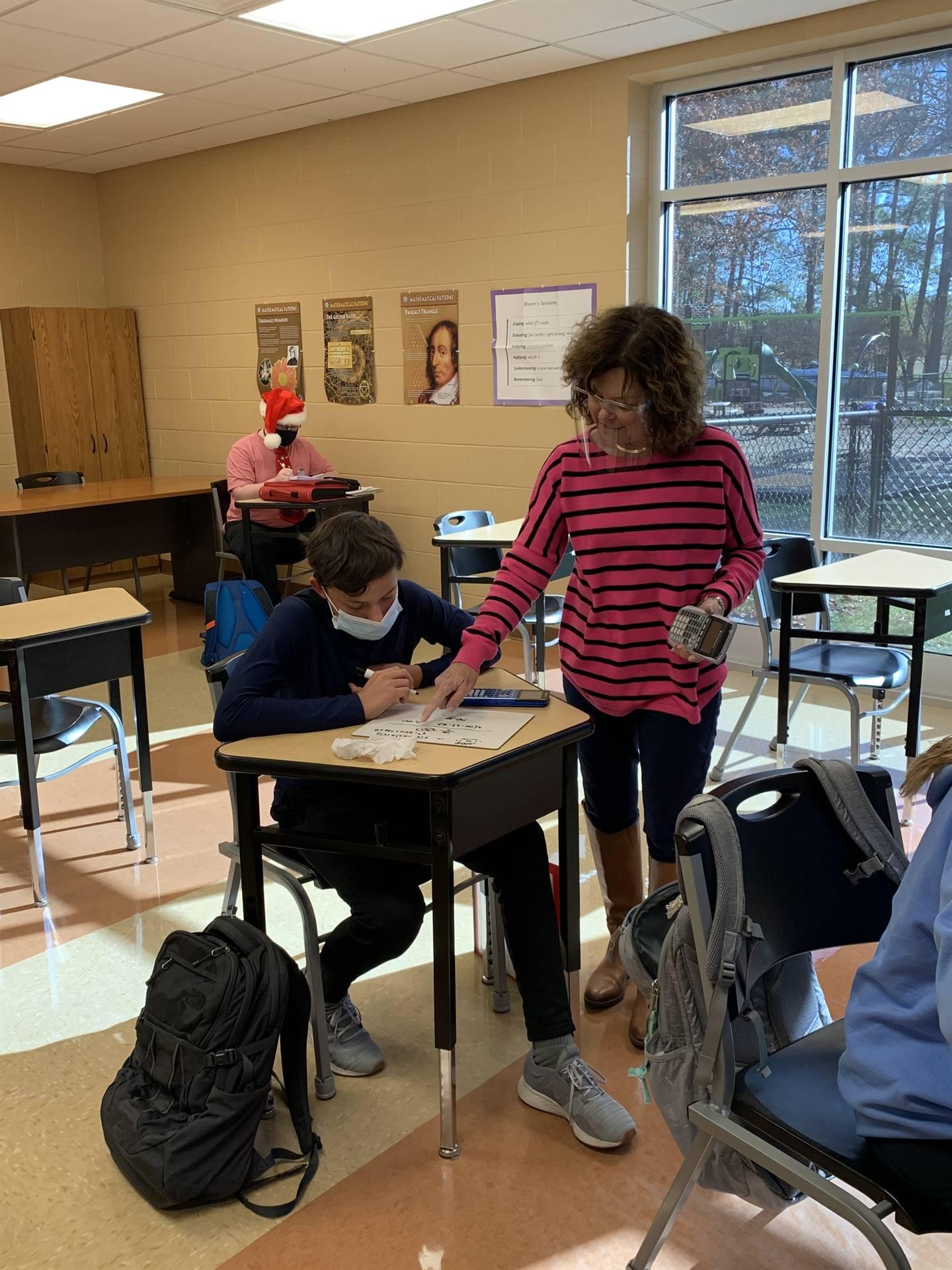 Teacher assisting student